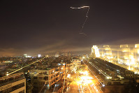 Damascus is seen as the U.S. launches an attack on Syria targeting different parts of the capital early Saturday, April 14, 2018. (AP Photo/Hassan Ammar)