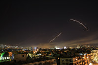 Missiles streak across the Damascus skyline as the U.S. launches an attack on Syria targeting different parts of the capital, early Saturday, April 14, 2018. (AP Photo/Hassan Ammar)