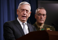 Defense Secretary Jim Mattis, joined by Joint Chiefs Chairman Gen. Joseph Dunford, speaks at the Pentagon, Friday, April 13, 2018, on the U.S. military response, along with France and Britain, in response to Syria's chemical weapon attack on April 7. (AP Photo/Carolyn Kaster)
