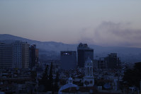Smoke rises after airstrikes targeting different parts of the Syrian capital Damascus, Syria, early Saturday, April 14, 2018. (AP Photo/Hassan Ammar)