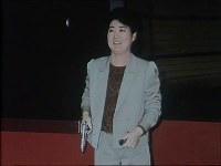 Ko Yong Hui, mother of North Korean leader Kim Jong Un holds a pistol. She was said to have undergone shooting training to protect Kim Jong Il. (Photo from the internal document