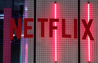 In this Nov. 4, 2017, file photo, the logo of American entertainment company Netflix is pictured at the Paris games week in Paris. (AP Photo/Christophe Ena)