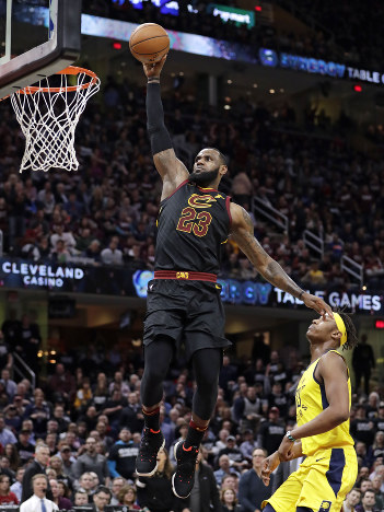 d6955d082f17 Cleveland Cavaliers  LeBron James (23) drives to the basket against Indiana  Pacers  Myles Turner (33) during the first half of Game 2 of an NBA  basketball ...