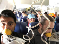 In this April 17, 2018, file photo provided by Marty Martinez, Martinez, left, appears with other passengers after a jet engine blew out on the Southwest Airlines Boeing 737 plane he was flying in from New York to Dallas, resulting in the death of a woman who was nearly sucked from a window during the flight. (Marty Martinez via AP)