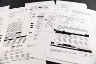 Copies of the memos written by former FBI Director James Comey are photographed in Washington, on April 19, 2018. (AP Photo/Susan Walsh)