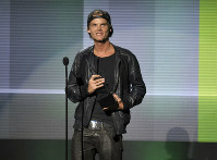 In this Nov. 24, 2013 file photo, Avicii accepts the award for favorite artist - electronic dance music at the American Music Awards in Los Angeles. (Photo by John Shearer/Invision/AP)