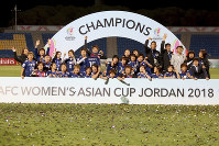 Japan players celebrate with the trophy after winning the AFC Women's Asian Cup Finals match against Australia at the King Abdullah II Stadium in the Jordanian capital. Japan defeated Australia 1-0 to win the cup in Amman, Jordan, on April 20, 2018. (AP Photo/Raad Adayleh)