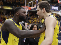 Indiana Pacers' Lance Stephenson, left, celebrates with Bojan Bogdanovic after Indiana defeated the Cleveland Cavaliers 92-90 in Game 3 of a first-round NBA basketball playoff series, on April 20, 2018, in Indianapolis. (AP Photo/Darron Cummings)