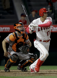 Los Angeles Angels' Shohei Ohtani watches his single against the San Francisco Giants during the ninth inning of a baseball game in Anaheim, Calif., on April 20, 2018. (AP Photo/Chris Carlson)
