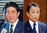 Prime Minister Shinzo Abe, left, and Finance Minister Taro Aso (Mainichi)