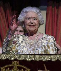 Queen Elizabeth II waves to the crowd at the Royal Albert Hall in London on Saturday April 21, 2018, for a concert to celebrate her 92nd birthday. (Andrew Parsons/Pool via AP)