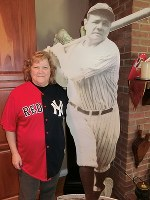 Linda Ruth Tosetti smiles as she stands next to a life-size photo of her grandfather and Major League Baseball legend Babe Ruth at her home in Durham, Connecticut, on April 22, 2018. (Mainichi)