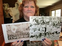 Linda Ruth Tosetti shows off photos of her grandfather and Major League Baseball legend Babe Ruth and other members of the Major League team that visited Japan in 1934 to play against a Japanese team, at her home in Durham, Connecticut, on April 22, 2018. (Mainichi)