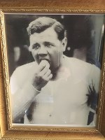 A photo showing Major League Baseball legend Babe Ruth eating a hot dog is on display at his granddaughter Linda Ruth Tosetti's home in Durham, Connecticut, on April 22, 2018. (Mainichi)