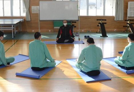 Inmates at Maebashi Prison in Gunma Prefecture take part in a mindfulness session in the city of Maebashi in this recent photo. (Mainichi)