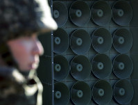 In this Jan. 8, 2016 file photo, a South Korean soldier stands near the loudspeakers near the border area between South Korea and North Korea in Yeoncheon, South Korea.(Lim Tae-hoon/Newsis via AP)