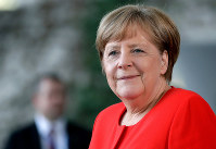 In this April 20, 2018, file photo, German Chancellor Angela Merkel waits for a meeting at the chancellery in Berlin, Germany. (AP Photo/Michael Sohn)