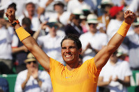 Spain's Rafael Nadal celebrates winning the men's singles final match of the Monte Carlo Tennis Masters tournament against Japan's Kei Nishikori in two sets, 6-3, 6-2, in Monaco, on April 22, 2018. (AP Photo/Christophe Ena)