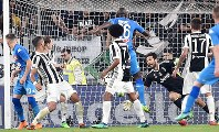 Napoli's Kalidou Koulibaly, top center, scores during a Serie A soccer match between Juventus and Napoli at the Allianz Stadium in Turin, Italy, on April 22, 2018. (Alessandro Di Marco/ANSA via AP)