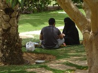 A man and woman rest in the shade of a tree in a park in Riyadh, Saudi Arabia, on April 17, 2018. (Mainichi)