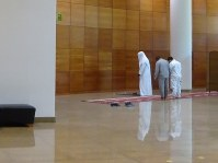Saudi men perform one of their daily prayers in a corner of a museum that faces Mecca, in Riyadh, Saudi Arabia, on April 16, 2018. (Mainichi)