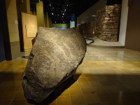 An ancient rock engraved with handprints discovered in the southern city of Najran is on display at the National Museum of Saudi Arabia in Riyadh, Saudi Arabia, on April 16, 2018. (Mainichi)