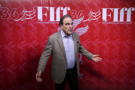 This photo provided by Tasnim News Agency, shows American movie director Oliver Stone in a photo opportunity while attending the Fajr International Film Festival, in Tehran, Iran, on April 23, 2018. (Hamed Malekpour/Tasnim News Agency via AP)