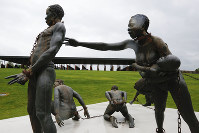Part of a statue depicting chained people is on display at the National Memorial for Peace and Justice, a new memorial to honor thousands of people killed in racist lynchings, on April 22, 2018, in Montgomery, Ala. (AP Photo/Brynn Anderson)