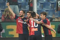 Genoa's Daniel Bessa, left, celebrates with his teammates after scoring his side's second goal during the Italian Serie A soccer match between Genoa and Verona at the Luigi Ferraris stadium in Genoa, on April 23, 2018. (Luca Zennaro/ANSA via AP)