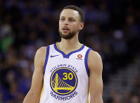 This March 6, 2018 file photo shows Golden State Warriors guard Stephen Curry during an NBA basketball game against the Brooklyn Nets in Oakland, Calif. (AP Photo/Jeff Chiu)