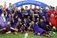 Barcelona's players celebrate their victory in the UEFA Youth League final soccer match between Britain's Chelsea FC U-19 and Spain's FC Barcelona Juvenil A, at the stadium Colovray Sports Centre, in Nyon, Switzerland, on April 23, 2018. (Laurent Gillieron/Keystone via AP)
