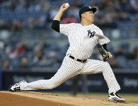 New York Yankees starting pitcher Masahiro Tanaka delivers during the first inning of a baseball game against the Minnesota Twins in New York, on April 23, 2018. (AP Photo/Kathy Willens)