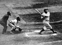 In this undated file photo, New York Yankees' Babe Ruth hits a home-run. (AP Photo/File)