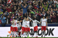 Salzburg's players celebrate after Stefan Lainer scored his side's fourth goal during the quarter final second leg Europa League soccer match between FC Salzburg and Lazio in Salzburg, Austria, on April 12, 2018. (AP Photo/Kerstin Joensson)