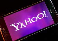 In this Dec. 15, 2016, file photo, the Yahoo logo appears on a smartphone in Frankfurt, Germany. (AP Photo/Michael Probst)