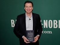 In this April 18, 2018 file photo, former FBI director James Comey poses with his book