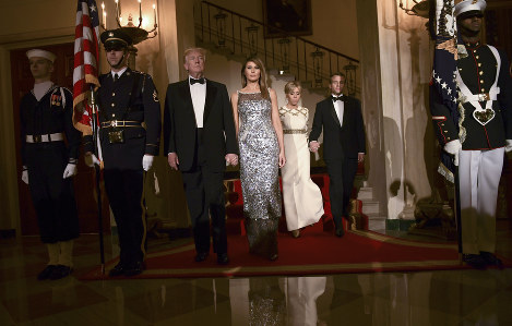 President Donald Trump, first lady Melania Trump, Brigitte Macron, and French President Emmanuel Macron walk down the Grand Staircase to pose for a photo in the Grand Foyer before a State Dinner at the White House in Washington, on April 24, 2018. (AP Photo/Susan Walsh)