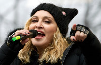 In this Jan. 21, 2017, file photo, Madonna performs on stage during the Women's March rally, in Washington. (AP Photo/Jose Luis Magana)