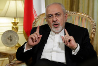 Iran's Foreign Minister Mohammad Javad Zarif is interviewed by The Associated Press, in New York, on April 24, 2018. (AP Photo/Richard Drew)