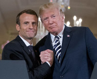 President Donald Trump and French President Emmanuel Macron embrace at the conclusion of a news conference in the East Room of the White House in Washington, on April 24, 2018. (AP Photo/Andrew Harnik)