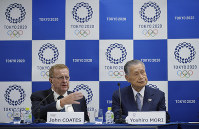International Olympic Committee (IOC) Vice President John Coates, left, speaks as Yoshiro Mori, president of the Tokyo Organizing Committee of the Olympic and Paralympic Games, listens during their joint press conference in Tokyo on April 24, 2018. (AP Photo/Eugene Hoshiko)