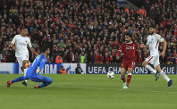 Liverpool's Mohamed Salah scores his side's second goal of the game against Roma during their Champions League, semifinal first leg soccer match at Anfield, Liverpool, England, on April 24, 2018. (Peter Byrne/PA via AP)