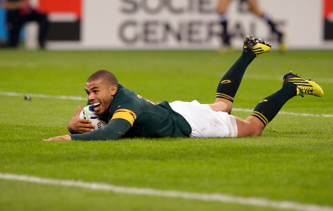 In this Oct. 7, 2015 file photo, South Africa's Bryan Habana scores his second try during the Rugby World Cup Pool B match between South Africa and USA at the Olympic Stadium, London. (AP Photo/Matt Dunham, file)