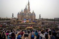In this June 16, 2016 file photo, performers take to the stage during the opening ceremony for the Disney Resort in Shanghai, China. (AP Photo/Ng Han Guan)