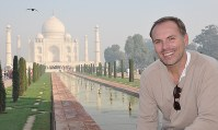 This undated photo shows John DiScala, better known as the air travel expert Johnny Jet, at the Taj Mahal in Agra, India. (Natalie DiScala via AP)