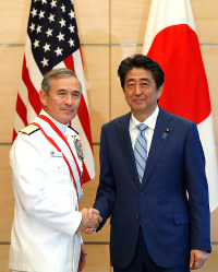 Admiral Harry Harris, Commander of the United States Pacific Command, left, and Japan's Prime Minister Shinzo Abe shake hands at Abe's official residence in Tokyo, Japan on April 26, 2018. (Issei Kato/Pool photo via AP)