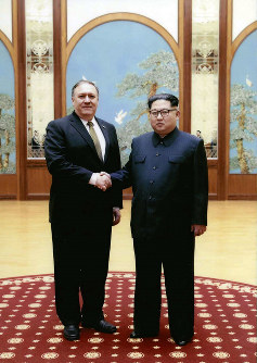 In this image released by the White House, then-CIA director Mike Pompeo shakes hands with North Korean leader Kim Jong Un in Pyongyang, North Korea, during a 2018 East weekend trip. (White House via AP)