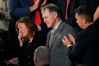 In this Jan. 30, 2018, file photo, the teary-eyed parents of Otto Warmbier, the American student who died days after being freed from imprisonment in North Korea, react to a standing ovation during President Donald Trump's State of the Union address to a joint session of Congress on Capitol Hill in Washington. (AP Photo/Pablo Martinez Monsivais, File)