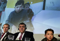 Eleven-year-old Syrian Hasan Diab talks during a press conference as a part of the video with his image is shown during a press conference in The Hague The Hague, Netherlands, on April 26, 2018. (AP Photo/Peter Dejong)