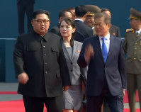 In this image taken from a video provided by Korea Broadcasting System (KBS), North Korean leader Kim Jong Un, left, walks with South Korean President Moon Jae-in and his sister Kim Yo Jong at the border village of Panmunjom in the Demilitarized Zone on April 27, 2018. (Korea Broadcasting System via AP)